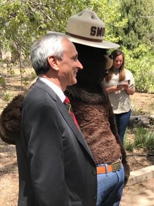 Secretary McQueen and Smokey Bear.