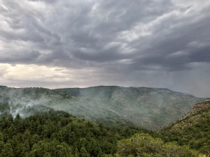 Smoke from the Cherry Fire can be seen from the bottom of the Sacramento Mountains as thunderstorms roll in.