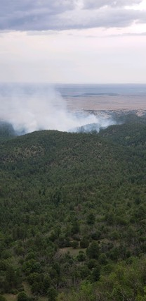 Smoke from the Dark Canyon Fire rises above the mountains