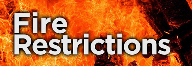 Fire restrictions graphic with flames in the background.